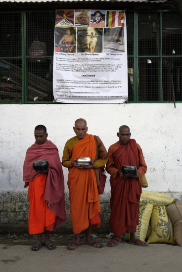 Indian Buddhist monks outside Dalai Lama's temple