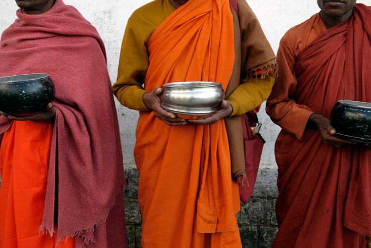 Indian Buddhist monks outside Dalai Lama's temple