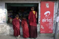 Tibetan monks at a shop in McLeodganj, Dharamshala