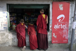 Tibetan monks at a shop in McLeodganj, Dharamshala