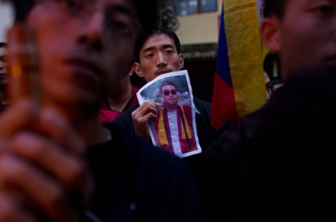 Tibetans hold candlelight vigil for immolations