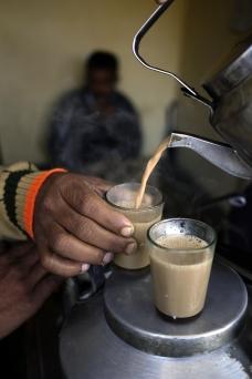 Closeup pouring Indian chai