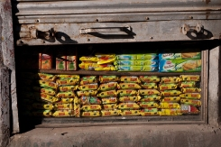 Instant noodles stacked in a shop window in McLeodganj. Photo by Angus McDonald
