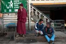 Porters and a Tibetan monk in the main square, McLeodganj, Dharamshala, India. Photo by Angus McDonald