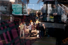 McLeodganj square reflected in the window of a taxi. Photo by Angus McDonald