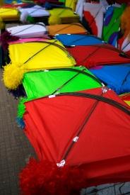 Kites for sale in Baroda, Gujarat, India ahead of the annual Uttarayan, or Makar Sakranti, kite flying festival. Photo by Angus McDonald