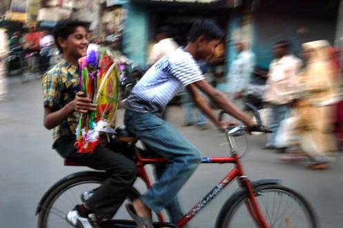 Boys deliver kites in Baroda, Gujarat, India ahead of the annual Uttarayan, or Makar Sakranti, kite flying festival. Photo by Angus McDonald