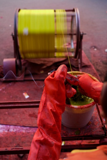 A man winds coloured kite string for sale in Baroda, Gujarat, India ahead of the annual Uttarayan, or Makar Sakranti, kite flying festival. Photo by Angus McDonald