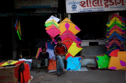 Kites for sale in Baroda, Gujarat, India ahead of the annual Uttarayan, or Makar Sakranti, kite flying festival. Photo by Angus McDonald