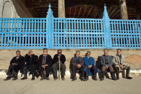 Old men in traditional Tajik clothes sun themselves outside a mosque near Panjikent, Tajikistan. Photo by Angus McDonald